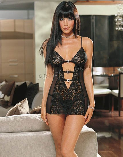 Black in color see through open front lace design in acrylic and spandex fabric.