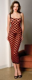 Sheer - checker pattern - wide right strap (for single shoulder look) and left spaghetti strap - one size fits most. 100% nylon.