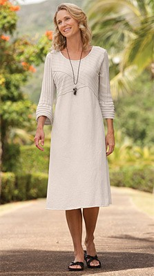 Three-Quarter-Sleeved Crossover Dress A mix of knits adds interest to our casual cotton crossover dress. The flattering crossover bodice is defined by wide ribbed knit; the easy A-line skirt is smooth jersey. Rounded neckline. Three-quarter sleeves with w