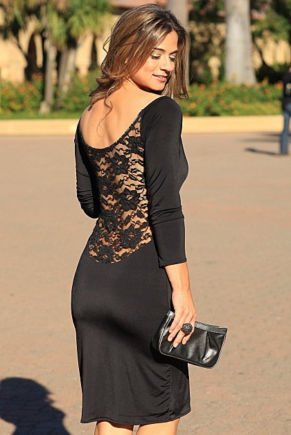 Ready to Tango?  This is one HOT dress!!!  Sassy, sexy, classy and totally gorgeous, this will be your all time favorite black dress.  Simple from the front and super seductive from the back, you are sure to get a ton of compliments!  Keep this dress in y