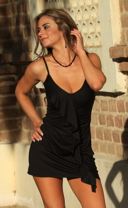 This little black dress is sassy and sexy. Cascading ruffles add a lot of personality to this short, simple dress.  Wear it to that special dinner, event or night out with the girls!  You will look so elegant.  Made from our wrinkle free black poly spande