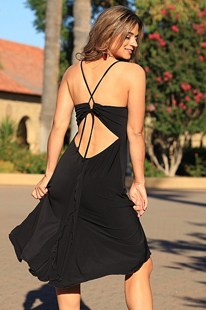 This dress is made to show off your best assests.  The slightly dipped front and unique back cut-out combined with a loose and flirty fit, will make this one of your favorite dresses.  Adjustable ties in back make for the perfect fit.  Imagine sipping a c