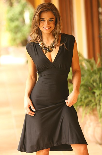 Classic and sexy. A deep plunging V neck and shirred shoulders as well as strings you can tie on the sides, tie in the front, or tie in the back. Totally body slimming and ready for that special occassion. Made from our black tactel fabric.