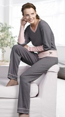 This comfy pajama set includes heather gray pajama pants and long sleeve sleeper top with pale pink trim and accents.