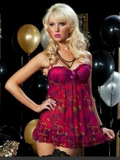 Flirty feminine style combines with fierceness in this rose and skull print set. • Molded cups • Ruffle trim • Bow detail